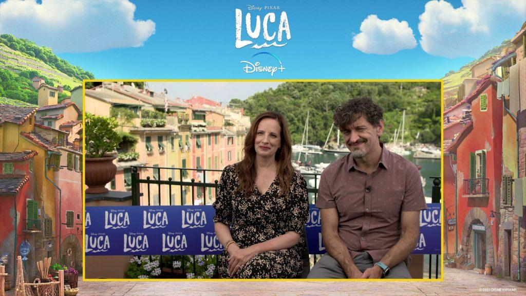 Andrea Warren and Enrico Casarosa in front of a view of Portofino, Italy
