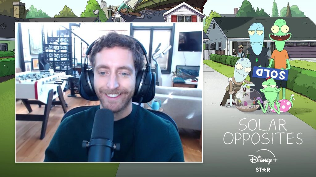 """Webcam shot of Thomas Middleditch on a """"Solar Opposites"""" branded background"""
