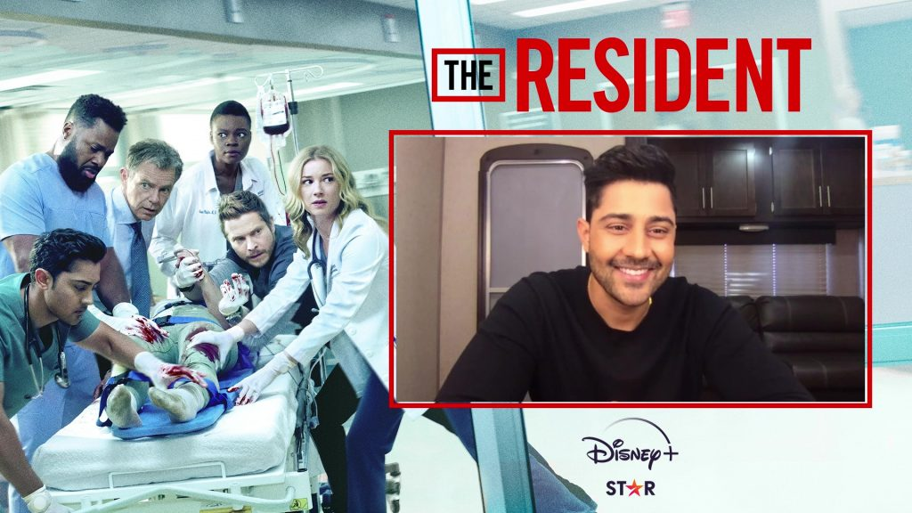 """Webcam shot of Manish Dayal on a """"The Resident"""" branded background"""